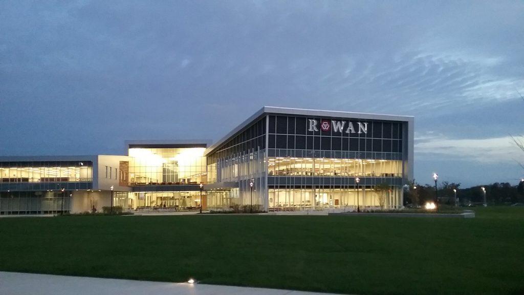 main glass building at Rowan College at Burlington County lit up at night, Rowan University partnership