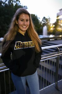 Alexa in her engineering hoodie outside the engineering building