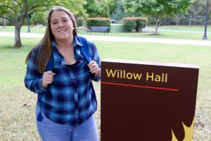 Maribeth at Willow Hall sign