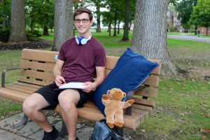 Brian with his essentials: pillow, headphones, and bear made at RAH event at Rowan University