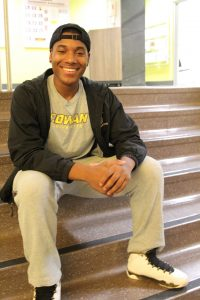 Nasir sitting inside the student center