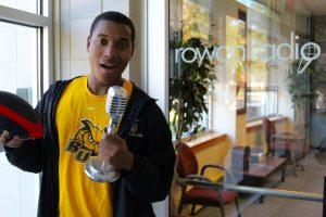 Nasir speaking into the mic at the Rowan Radio