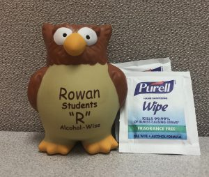 Rowan Prof shaped stress ball stands next to Purell alcohol wipes