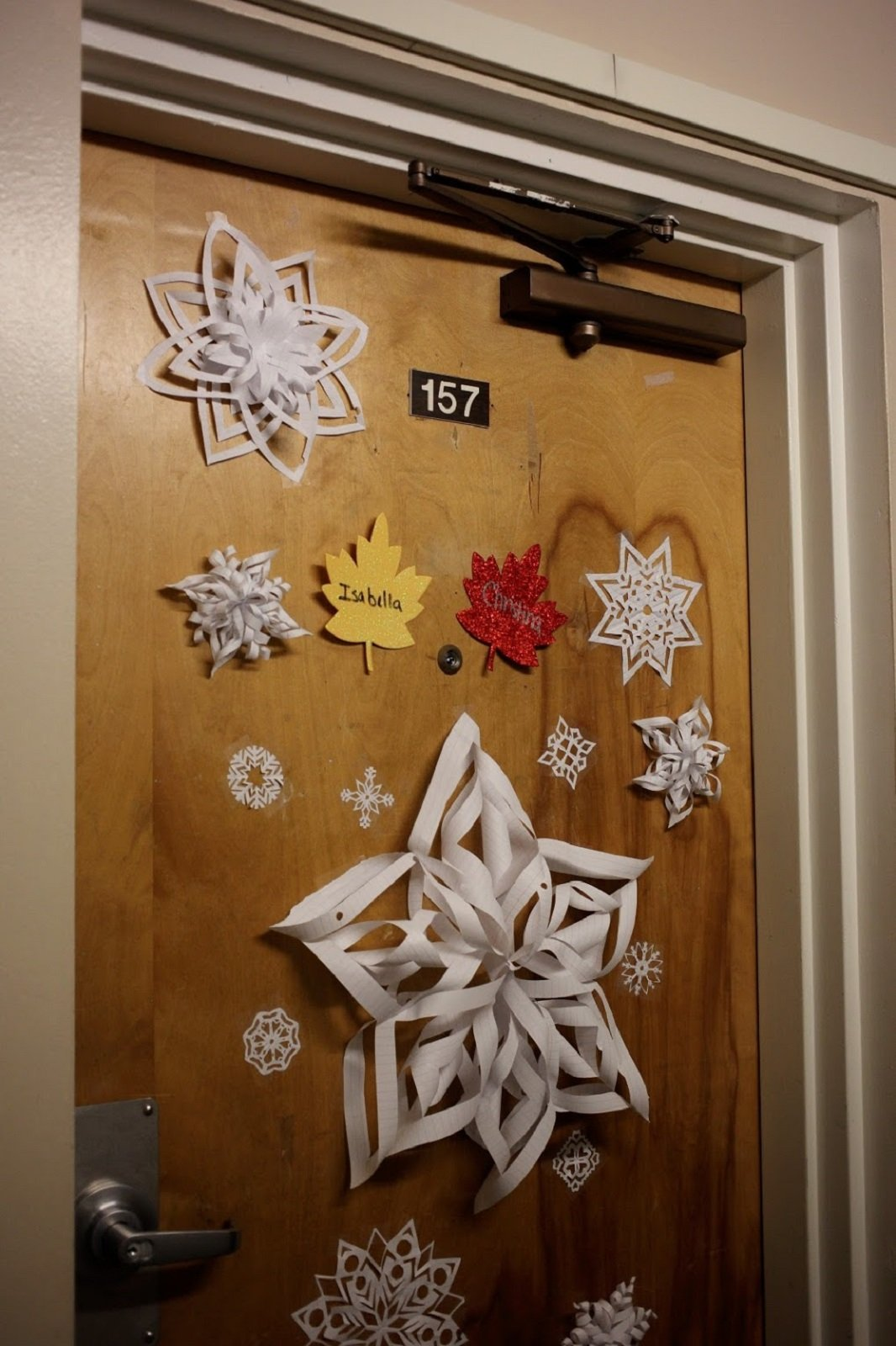 paper snowflake decorations on the door of residents in Chestnut Hall.