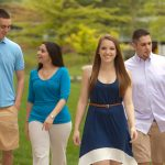 Rowan University students walking outside of Campbell Library