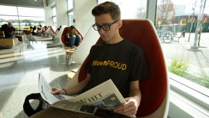 Rowan student Dylan reading Rowan's newspaper The Whit inside the Henry M. Rowan College of Engineering