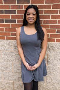Rowan University student Nikki pictured at brick wall