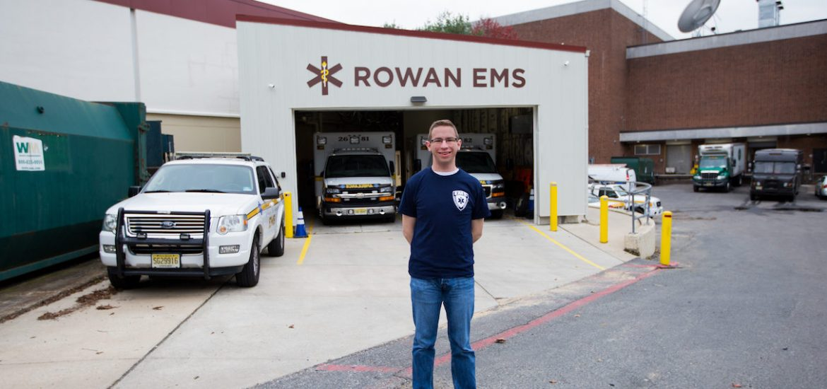 Rowan student Kevin standing outside Rowan EMS building