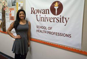 Nikki at the School of Health Professions sign at Rowan University