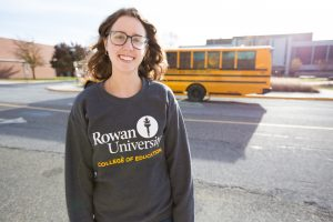 Chrissie at Rowan University outside James Hall in College of Education sweatshirt