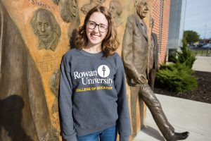 Rowan student Chrissie outside James Hall in College of Education sweatshirt