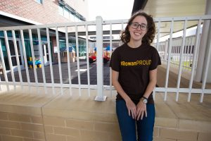 Chrissie in #ROWANproud shirt outside James Hall at Rowan University