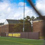 Rowan University sign on turf field outside Rec Center