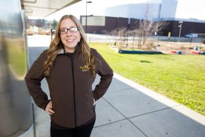 Rowan admissions ambassador outside of James Hall with Wilson Hall in the background
