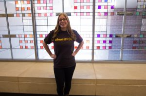 Rowan student in #ROWANproud tee shirt inside of James Hall on Rowan campus