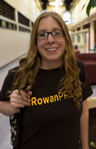 Rowan student in #ROWANproud teeshirt inside James Hall - education building at Rowan
