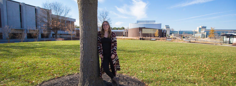 Education major Melissa outside of Robinson Circle at Rowan University campus