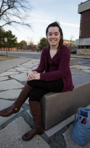 Jen sitting outside Robinson Circle at Robinson hall at Rowan