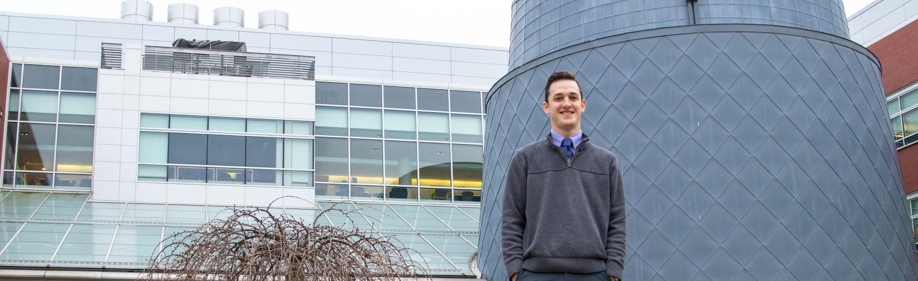 Andrew, a Translational Biomedical Sciences major at Rowan University, outside Science Hall.