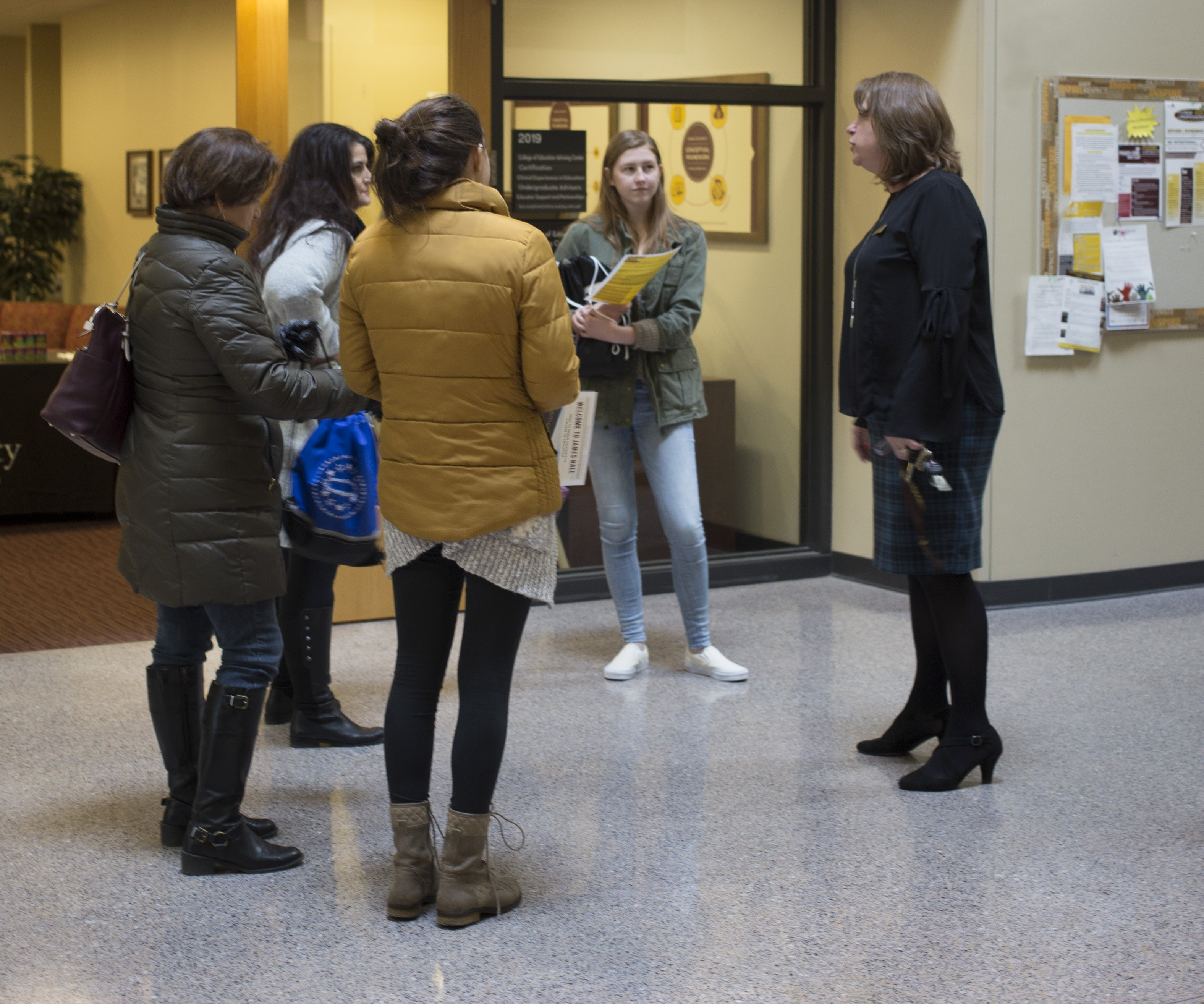Maureen Scott, the Coordinator of the College of Education, talks with potential Education majors in James Hall at Rowan University.