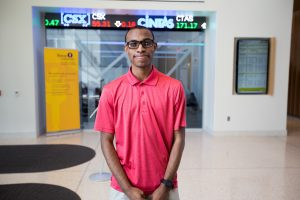 Davon inside the business building at Rowan University outside the stock room