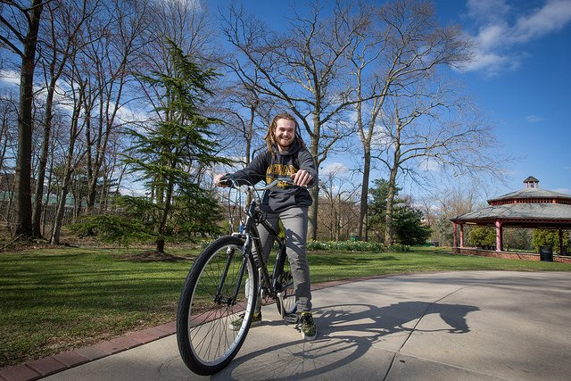 Rowan University student on a bike