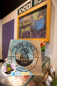 Inside Playa Bowls on the Rowan Blvd, with Stunited sticker