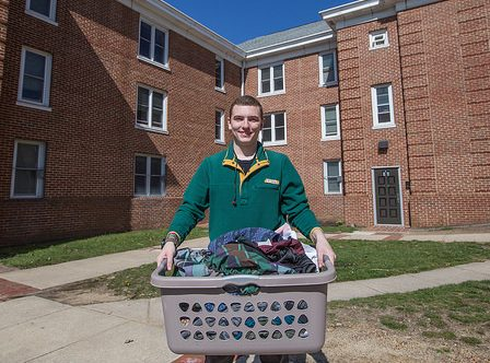 Chesnut Hall resident carries laundry at Rowan University