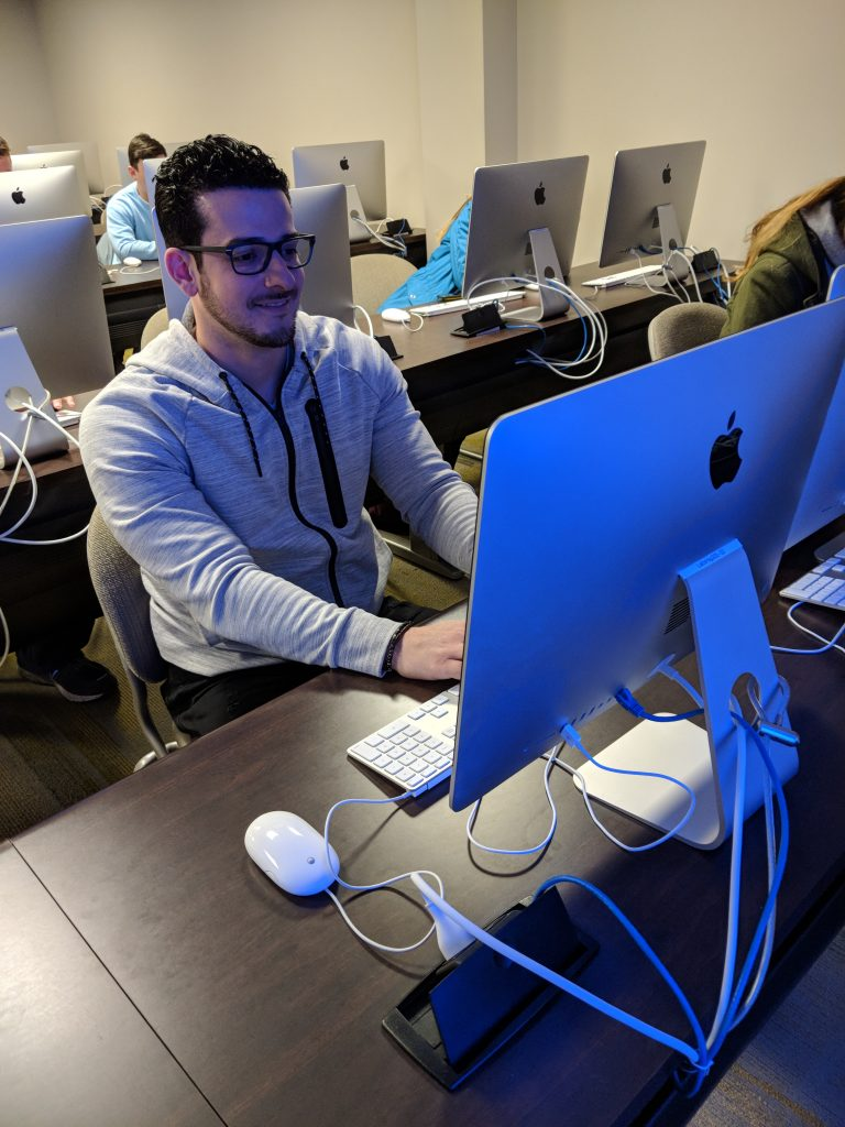 Brandon, a Rowan University student inside a computer laptop on a macbook