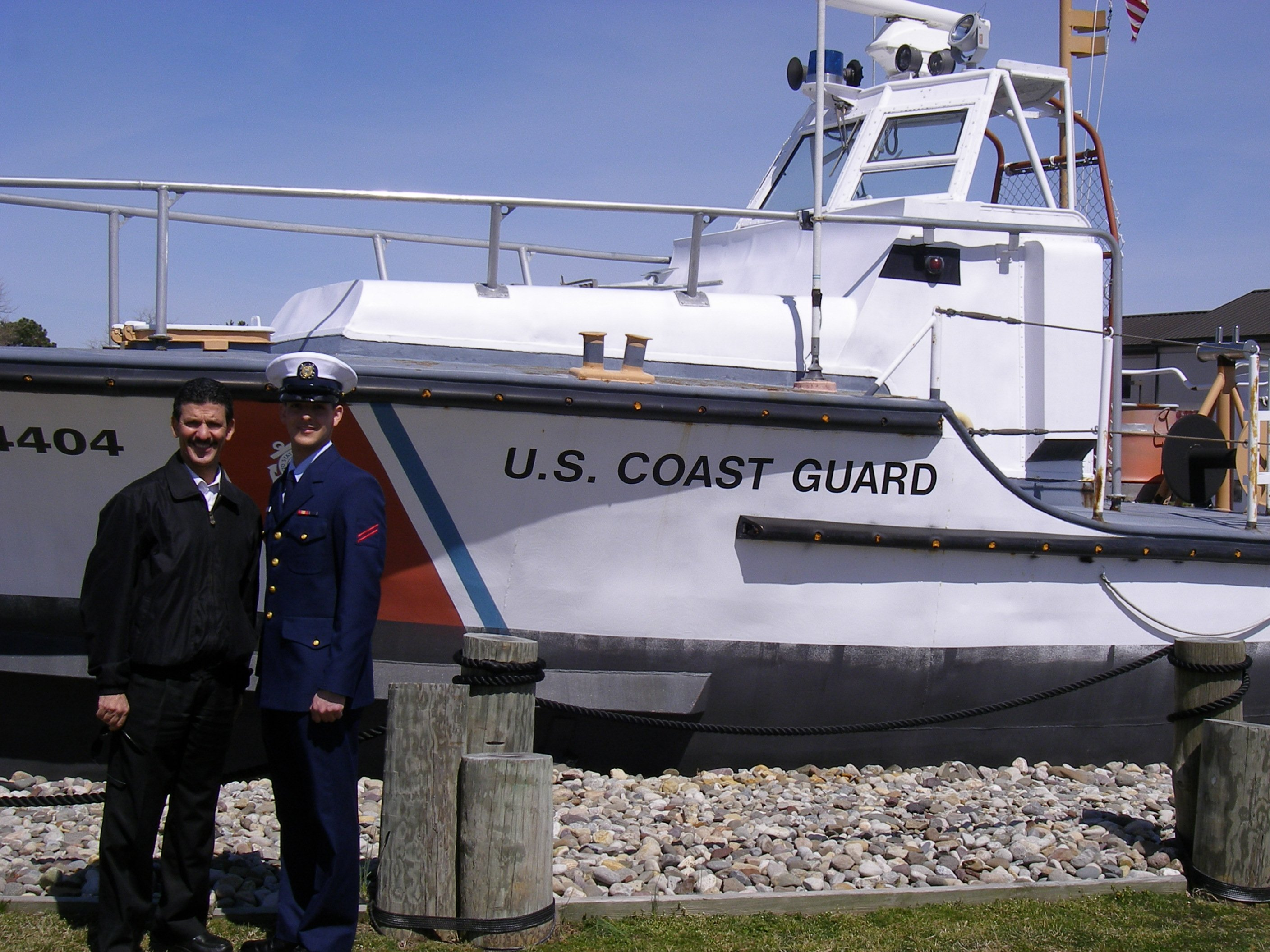 Brandon, a Rowan Student by a US Coast Guard Boat