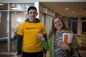 new rowan university student wears #rowan2022 tshirt next to his mom