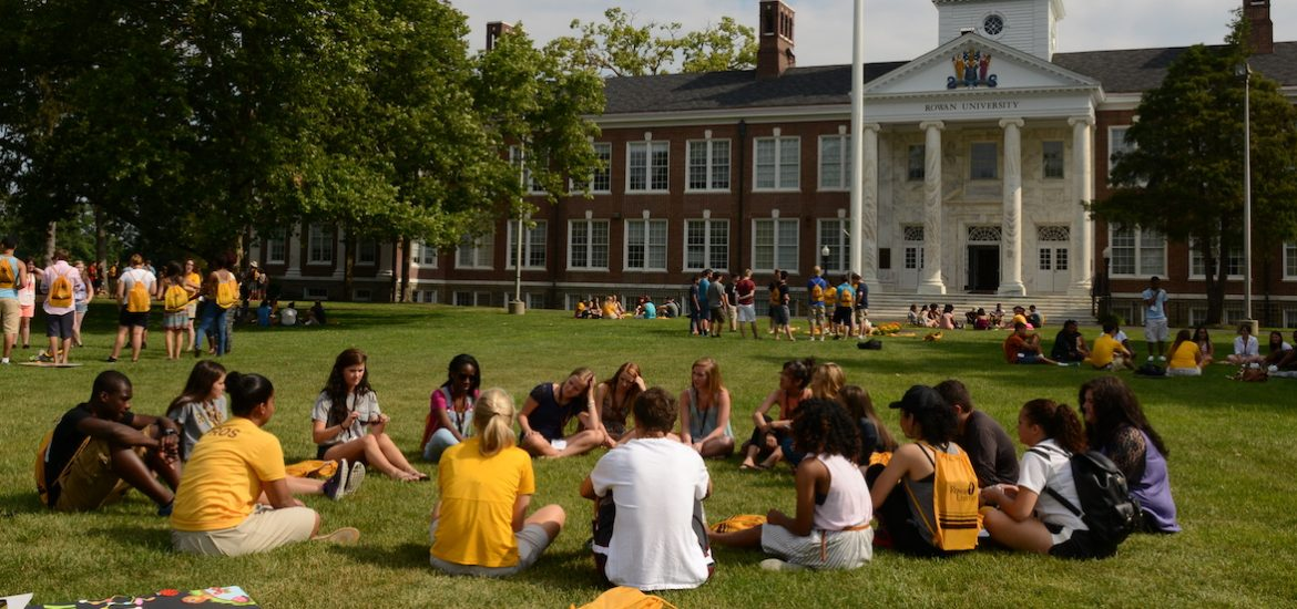 A group of PROS rowan students sitting in a circle outside Bunce Hall