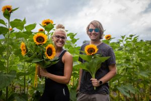 Rowan University students pose with sunflowers they picked at Hill Creek Farms