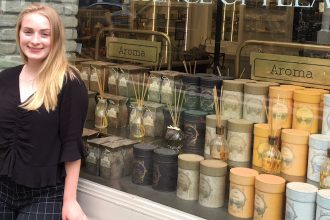Nicole stands in front of the window front of NYC's Sabon for her Rowan University internship