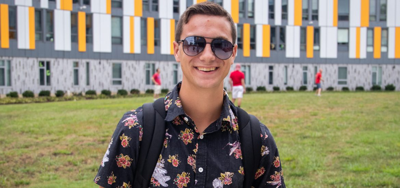 freshmen student outside Holly Pointe