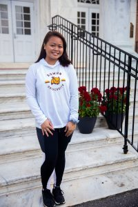 student wearing a rowan athletics hoodie outside Bunce steps