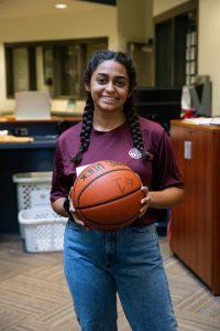 student in rec center with basketball