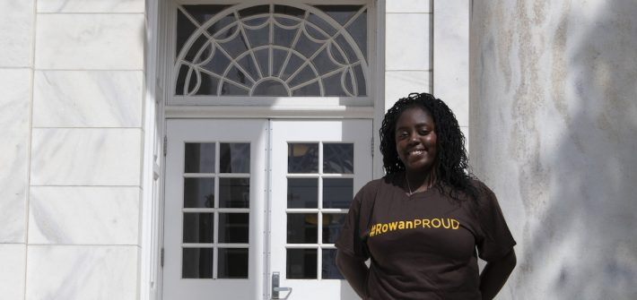 Edris, a rowan university transfer student, outside bunce hall