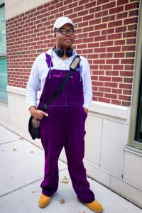 student wearing purple velvet overalls on the rowan blvd.
