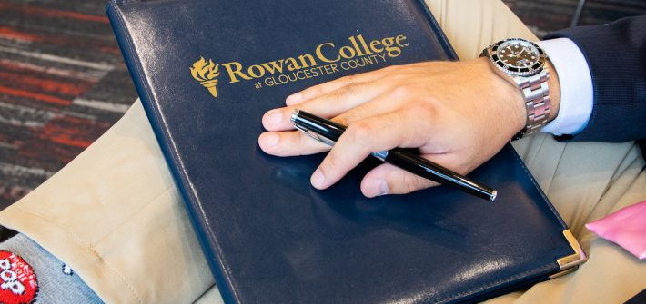 business folder and student at Rowan University