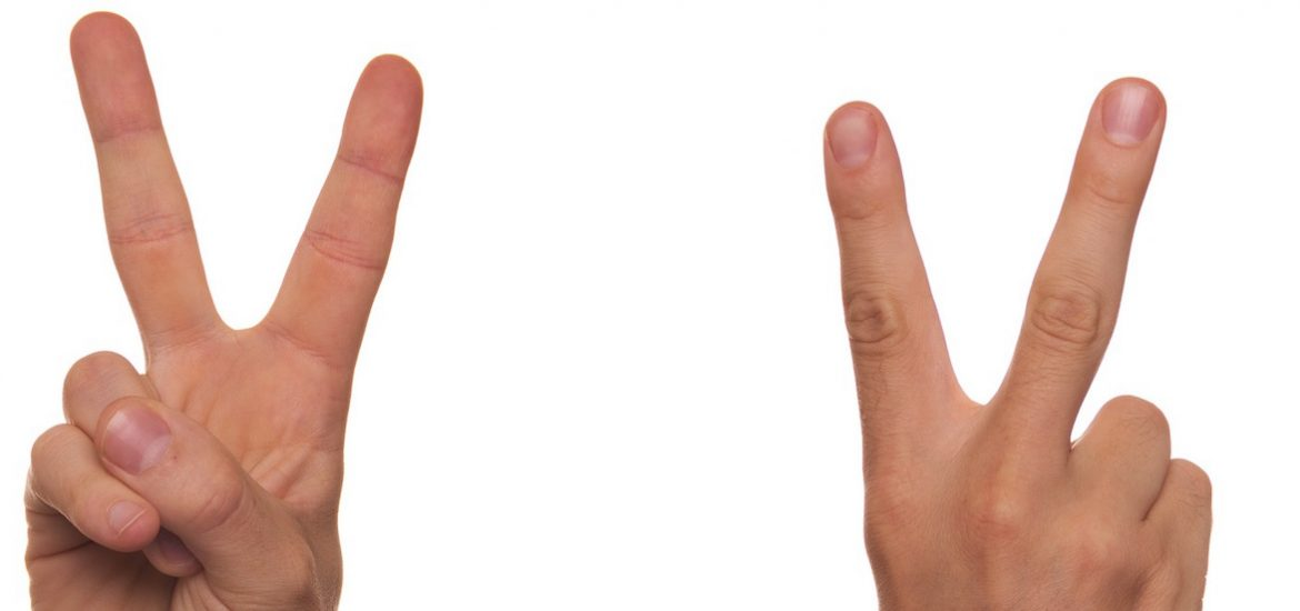 close up of fingers making peace sign with two hands