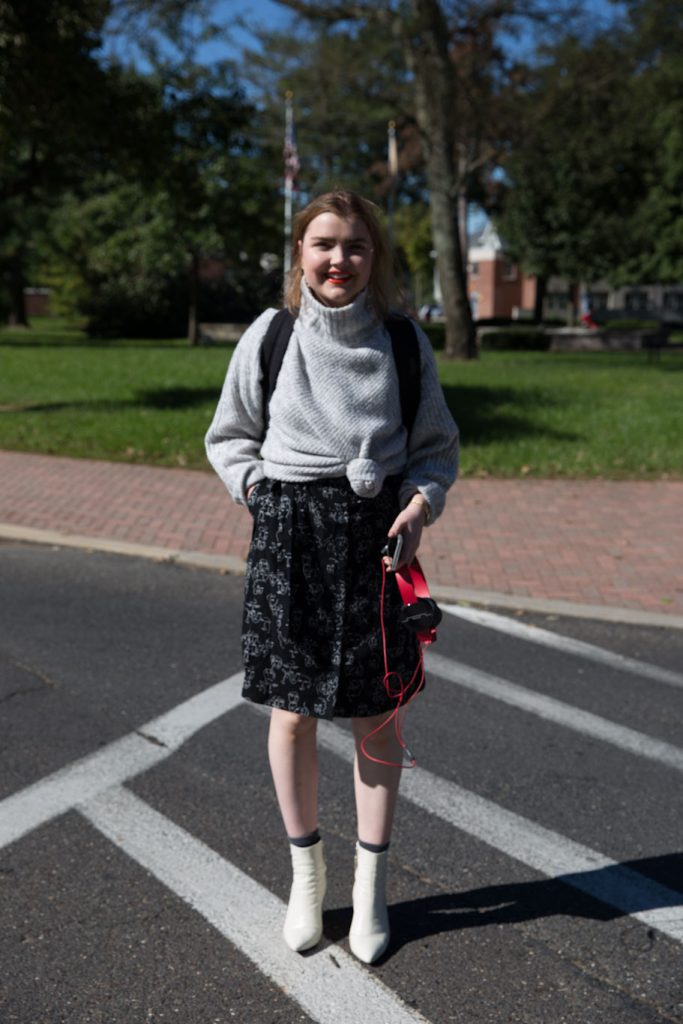 Kylie Westerbeck stands in the street on campus.