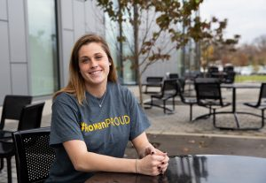 Rachel in her #ROWANproud shirt outside at a table at Rohrer College of Business