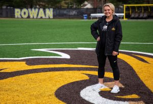 Kylie outside on soccer field at Rowan