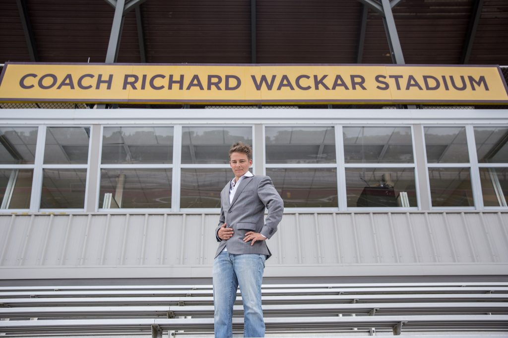 Professor Emil Steiner standing on the bleachers of Richard Wacker Stadium