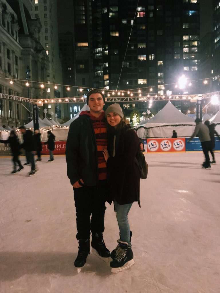 Rowan students posing on ice rink in Philly.