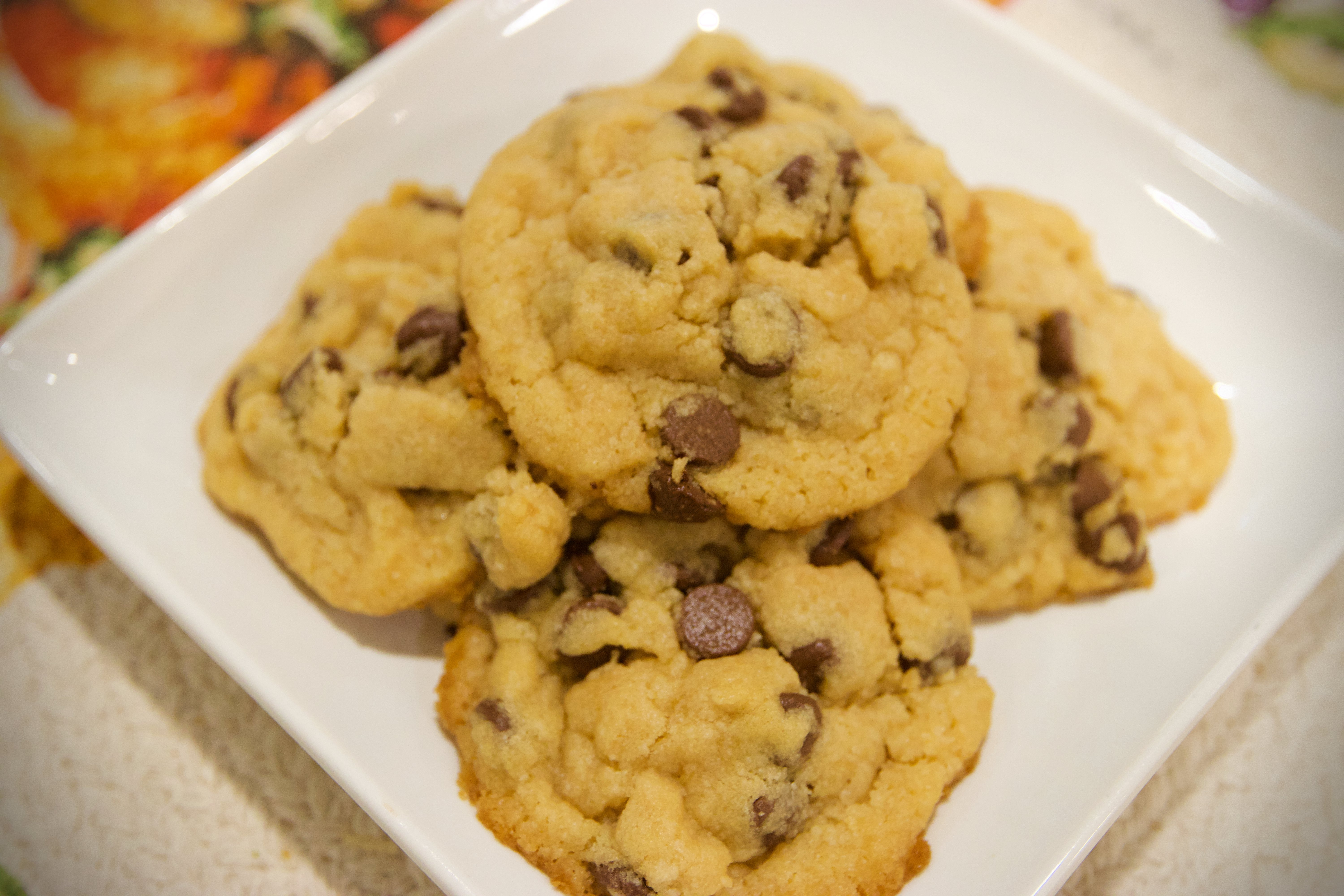 Picture of baked chocolate chip cookies on plate.