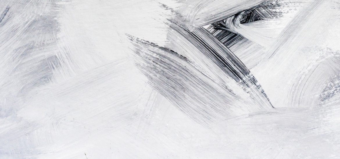 stock photo of white and black abstract paint strokes on canvas