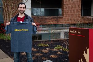 David holding #ROWANproud shirt outside Savitz Hall
