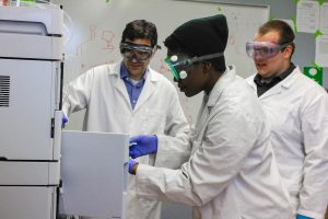 Analytical chemist James Grinias at Rowan University opens door to equipment with students